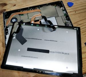 The Microsoft Surface Pro 4 being disassembled. This is a very tricky job because it the tight design and use of glue. Not damage to the screen on the way in!